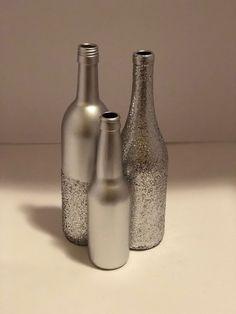 Wine bottle centerpieces Liquor Bottle Crafts, Wine Bottle Corks, Diy Bottle, Be. Glitter Wine Bottles, Wine Bottle Flowers, Wedding Wine Bottles, Christmas Wine Bottles, Painted Wine Bottles, Liquor Bottle Crafts, Wine Bottle Corks, Diy Bottle, Beer Bottle Centerpieces
