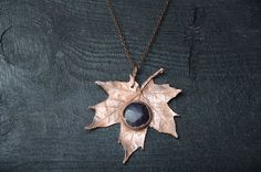 Maple leaf in copper (electroplating) with amethyst cabochon 1 (2.5 cm). The pendant approx. 3-1/2 inches ( 9 cm ) in diameter Please choose the length of chain. --------------------------------------------------------  Please Note that monitor settings may vary from computer to computer and may distort actual colors.  You can see all items in my jewelry-shop: https://www.etsy.com/shop/DolgovaSvetlana  also You can visit my Accessories-shop: https://www.etsy...