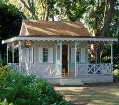 Sweet southern style tiny veranda. This would make a wonderful play house for my little girl!