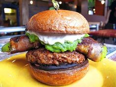 I'm eating this tomorrow at Mi Mero Mole for Portland Burger week 2014.  Chorizo patty on brioche bun with refried black beans, guacamole, pickled red onions, especial sauce, and bacon-wrapped hatch chile relleno.