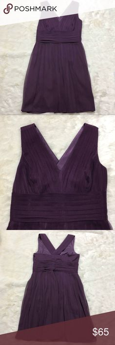 NWT Ann Taylor Silk Dress SZ 6 NWT - never used, no defects, stains, damage.  Beautiful regal purple dress, 100% Silk soft and flowy, flattering v neck and waistband that accentuates figure. Perfect for formal occasions ! Ann Taylor Dresses