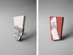 By Karen Pontoppidan, (left) Canvas#6, 2010, brooch, canvas, wood, tin, silver,  (right) Canvas#17, 2010, brooch, canvas, wood, tin, silver.