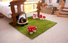A green Ikea rug... with felt mushrooms! I love how it looks like grass but would still be soft underfoot. Must do this!