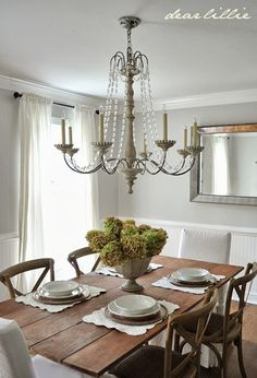 Simple Interior design ideas. Keep it light and easy. Sheer curtains ( very inexpensive). Table recycle reuse pick up at a garage sale, same with the mirror this room to be done for under $500.
