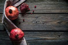 Ripe pomegranates, napkin and table  by OS  on @creativemarket