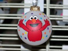 Hey, I found this really awesome Etsy listing at http://www.etsy.com/listing/81343298/handpainted-elmo-christmas-ornament