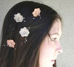 Will be using flowers in all the bridesmaids' hair. Something similar, cute, vintagey and flowy!
