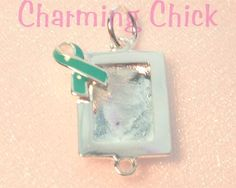 This teal ribbon picture frame charm is a great way to remember a loved one or show your support for a Survivor.