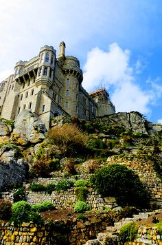 St. Michael's Mount, Cornwall, England. Located on a causeway, can be accessed by foot on a low tide :)