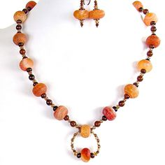 """Glow: 20"""" Semi-Precious Jewelry in Orange  Warm up your fall wardrobe and get your inner glow going with this handmade necklace set in rich orange crackle agate and poppy jasper."""