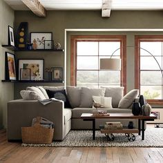 I think I could actually pull off a similar look in the living room.  Only instead of a magazine basket next to the couch, it would be my spinning wheel.