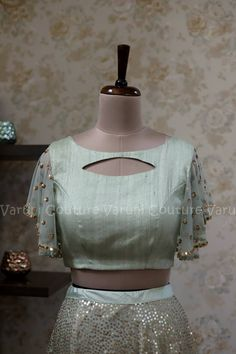 Pastel cyan georgette skirt with sequence work all over paired with flutter sleeve croptop Stylish Blouse Design, Fancy Blouse Designs, Bridal Blouse Designs, Blouse Neck Designs, Skirt Blouse Design, Sleeve Designs, Blouse Styles, Kurta Neck Design, Designer Blouse Patterns