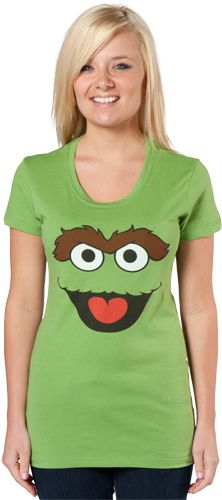 This Oscar The Grouch shirt features the face of Sesame Streets' grouchy garbage…