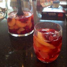 Skinny girl white cranberry Cosmo + frozen raspberries and peaches (or whatever fruit you like)