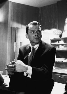 """Frank Sinatra in between takes during the making of """"Ocean's Eleven"""", c. 1960. Photo by Bob Willoughby"""