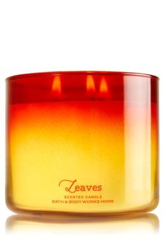 "Leaves - 3-Wick Candle - Bath & Body Works - The Perfect 3-Wick Candle! Made using the highest concentration of fragrance oils, an exclusive blend of vegetable wax and wicks that won't burn out, our candles melt consistently & evenly, radiating enough fragrance to fill an entire room. Beautiful ombr�-colored glass adds a pop of fall color to your d�cor! Burns approximately 25 - 45 hours and measures 4"" wide x 3 1/2"" tall."