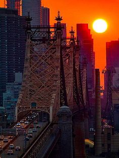 Sultry Sunset in NYC by Inga SardaSorensen - Big, bold sun sets by Street Bridge in New York City. The Places Youll Go, Places To See, Beautiful Sunset, Beautiful Places, Amazing Sunsets, Simply Beautiful, New York City, London City, Magic Places