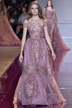 On the runway | For the runway showthe model wore her hair down, while Lily chose to wear it up (probably to better show off the neckline). Which do you like better? Zuhair Murad Spring/Summer 2017 Photo:Gamma-Rapho via Getty Images  via @AOL_Lifestyle Read more: http://www.aol.com/article/lifestyle/2017/01/08/runway-to-red-carpet-golden-globes-dresses-then-and-now/21650587/?a_dgi=aolshare_pinterest#fullscreen