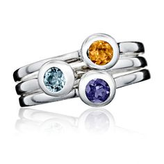 Crescent Moon Stacking Birthstone Rings. One for each of your loved ones. Choose sterling silver, gold vermeil, or solid14K gold, each set with a genuine gemstone. Mix and match with our star birthstone rings, and build your own family constellation over time.