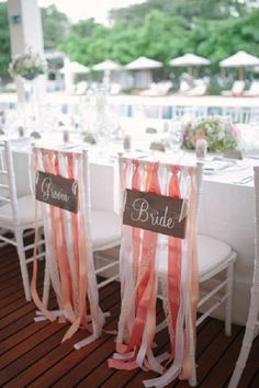 white wedding chair with coral ribbons
