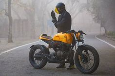 Black and yellow cafe racer and Bubble helmet