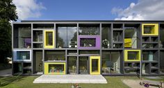 s day care centre for 7 groups ADDED VALUE The colourful facade frames are a characteristic feature of the new kindergarten on the outside and a means to provide varied space for creative play inside. The two-storey new build is. Facade Architecture, School Architecture, Kindergarten Design, Kids Daycare, Youth Center, Arch Interior, Interior Design, School Building, School Photography