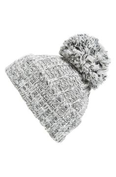 Adorable knit beanies with a lush pom pom at the top are totally on trend for winter. Especially loving this light grey color that pairs easily all season long.