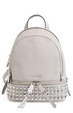 In Black of course MICHAEL Michael Kors 'Extra Small Rhea Zip' Studded Backpack available at #Nordstrom  Diese und weitere Taschen auf www.designertaschen-shops.de entdecken