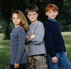 Daniel Radcliffe, Rupert Grint, and Emma Watson in Harry Potter and the Philosopher's Stone