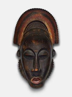 Baule, Ivory Coast, Africa, Portrait Face Mask (Mblo) with Crest, 19th century from the Alfred Stieglitz Collection at Crystal Bridges.  Page includes curator commentary.  Relates to Portrait mask (Mblo). Baule peoples (Côte d'Ivoire). Late 19th to early 20th century C.E. Wood and pigment.