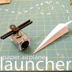 Launch mini paper airplanes from your desk, without ever winding up your arm. Perfect for office shenanigans or other indoor fun! By using common electrical components we can make our own electric paper airplane launcher! You might even discover you have many of the parts required already laying around, especially if you have any old toys with small DC motors. Check out the launcher in action: Pretty neat, right? Enough talk, let's launch some airplanes!