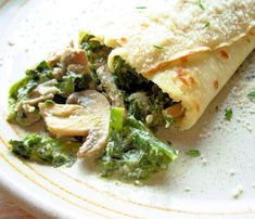 "Savory Mushroom, Spinach & Cheese Crepes: ""Packed with lots of fresh ingredients, these can be made ahead and heated just before serving -- a perfect dish for company or a quick evening meal."" - Tenney - very healthy and looks juicy Vegetarian Recipes, Cooking Recipes, Healthy Recipes, Crepes Party, Dinner Crepes, Homemade Crepes, Savory Crepes, Breakfast Recipes, Mexican Breakfast"