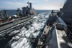 The amphibious transport dock ship USS San Diego maneuvers alongside the fleet replenishment oiler USNS Guadalupe for a replenishment at sea during a training exercise in the Pacific Ocean, April 11, 2017.