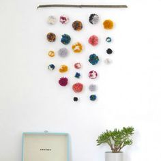 this simple wall hanging is a great alternative to hanging prints and takes no time to make!