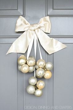 DIY Ornament Door Decoration using Dollar Store Ornaments! Only takes 30 minutes! via @Taryn {Design, Dining + Diapers}