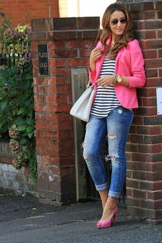 pink blazer with ripped jeans, a white bag and a striped top