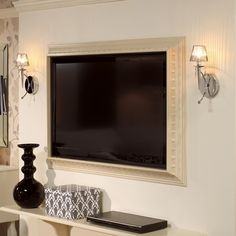 SO neat!! frame a flat-screen TV using crown molding... yes for the bedroom!.