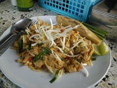 Pad Thai (a stir-fried rice noodle dish with ingredients such as eggs, tofu, peanuts, bean sprouts and usually fresh shrimp) with heart of palm on the side. A yummy stop roadside for lunch!