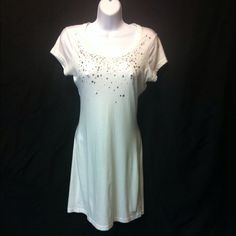 Guess White T-Shirt Dress In good condition with little wear. Lots of bling along chest. Guess logo sewn on left  bottom of the dress's front. It is somewhat thin and sheer but very comfortable Guess Dresses