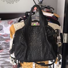 Alexander wang Rocco bag Black leather with rose gold studs, zippers an details .  Good condition accept zipper at top of bag loose needs to be fixed due to this low price .  No big visible signs of wear good inside and outside .  Side zipper and inside zipper work fine.  The extended strap has some discoloring at top can be seen in pic.. But other than that great condition..across 13 inches up and down 11 inches 8 inches in width and depth between 8-9 inches Alexander Wang Bags
