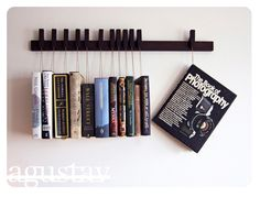 Custom made wooden book rack / bookshelf in Wenge. Pins also work as bookmarks. Bookcase. $210,00, via Etsy.