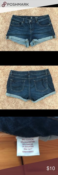 "Dark Wash Denim Shorts Dark wash jean shorts with about a 2 1/2"" inseam and 5 pockets. Size 13 Juniors, which fits around a 10 to 11 in Women's bottoms. In good shape (no tears, stain, etc.) and they hold up well in the wash. Very comfortable ""denim,"" as the fabric is 56% Cotton, 22% Polyester, 21% Rayon, and 1% Spandex. SO Shorts Jean Shorts"