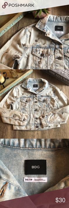 """BDG Blue Boyfriend Denim Graffiti Trucker Jacket Awesome graffiti Jean jacket  Has 4 pockets on the front and two hidden ones on the inside   Has two little knicks on the back but looks like it's part of the jacket.   Bust: 19""""  Waist:19""""  Length: 18"""" BDG Jackets & Coats Jean Jackets"""