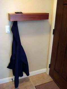 Behind the door coat rack/shelf