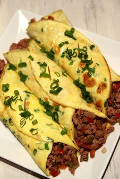 Minced Beef Egg Burritos ... this is great idea to change this up .... I'd take out onions and add avocado & sour cream to balance macronutrients!!! Yum!