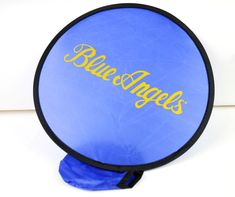 """BLUE ANGELS FOLDING FLYER / FAN   10"""" NYLON FLYER FLEXIBLE CONSTRUCTION FOLDS WHEN NOT IN USE TO FIT IN A 3.5""""X4"""" POCKET CASE.   CAN BE USED TO COOL YOURSELF DOWN OR TO ENJOY A FUN GAME OF FRISBEE!"""