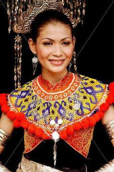 Lady in Iban traditional costume. Kuching. Malaysia (2006)