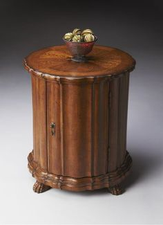 Butler Drum Table, Vintage Oak Finish by Butler. $469.00. Hand carved details; Selected solid woods, wood products and choice veneers; Door with antique brass finished hardware; Vintage Oak finish; Maple, walnut and cherry veneers inlay top with oak veneer border. This distinctive drum table brings a classic 18th century design into the 21st century. Made from select solid woods and choice veneers, this accent table will bring quality and charm to your home. Its single door has...