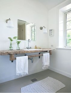 Bathroom in white with a washstand made of weathered wood via Planete Deco