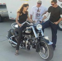 Angelina Jolie with motorcycle and Brad Pitt